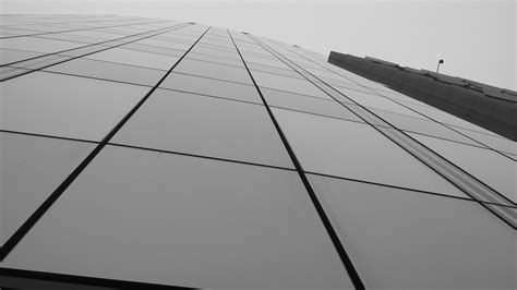 Low Angle Glass High Rise Building · Free Stock Photo