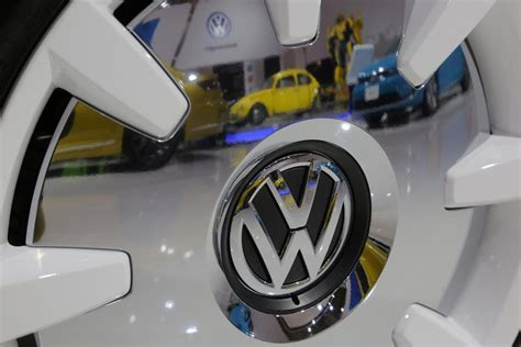 Volkswagen settles emissions class action with three